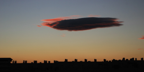 Cloud at dusk over the skyline of Alicante, Spain.